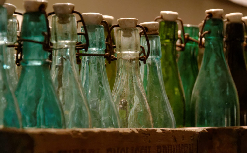 several empty blue-shaded bottles