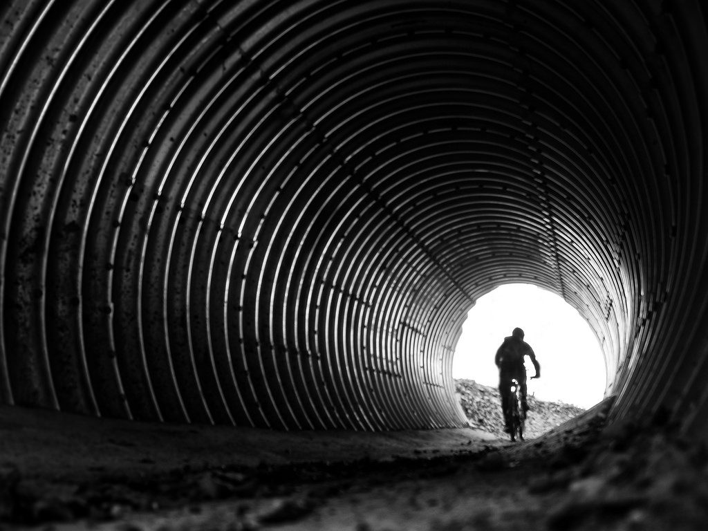 biker exiting a tunnel