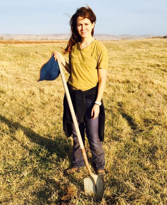 girl at standing rock with shovel
