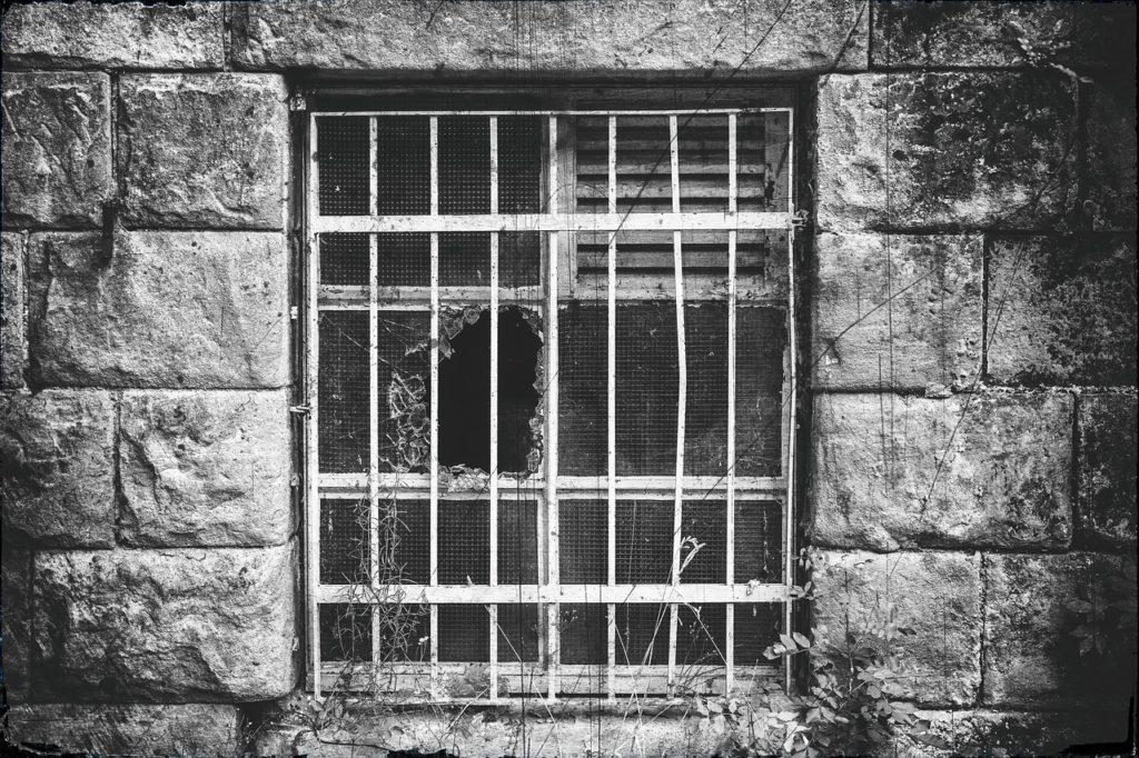 black and white broken window
