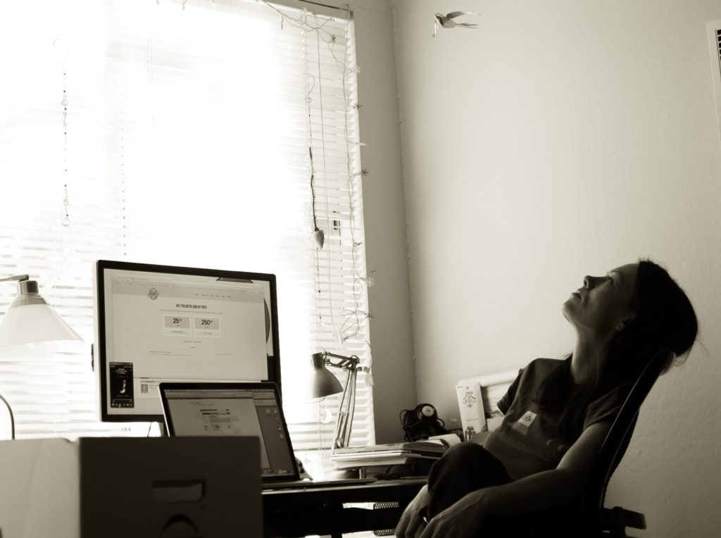 lady daydreaming at desk