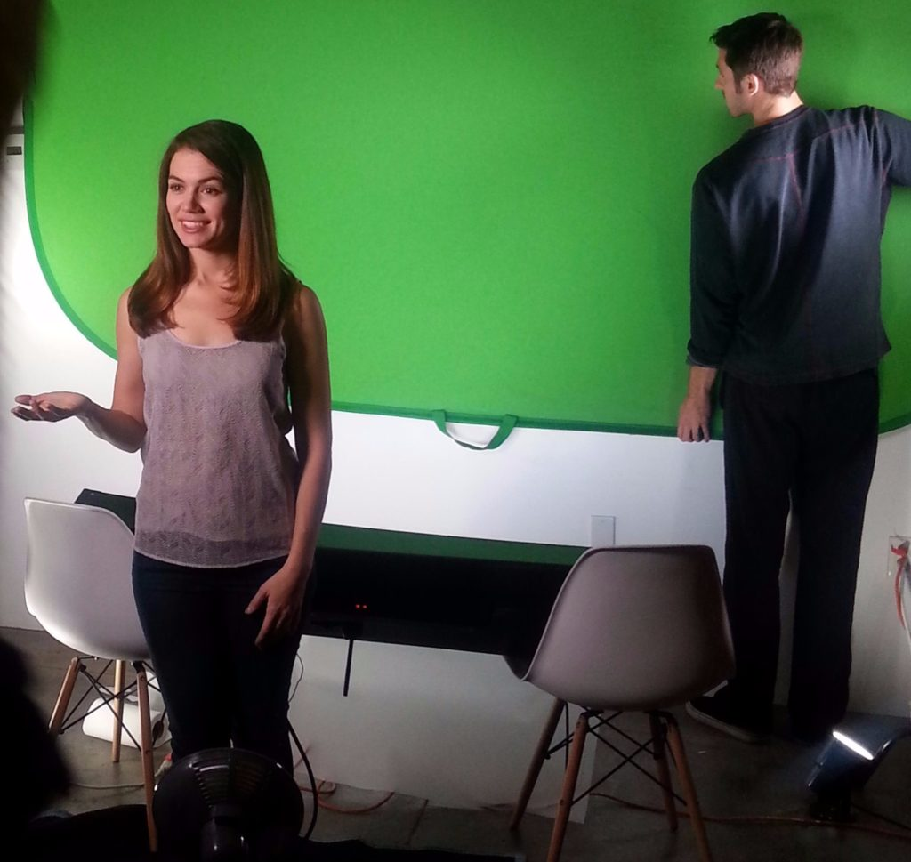 girl acting in front of green screen