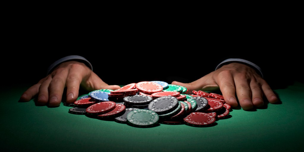 pile of poker chips being pushed in