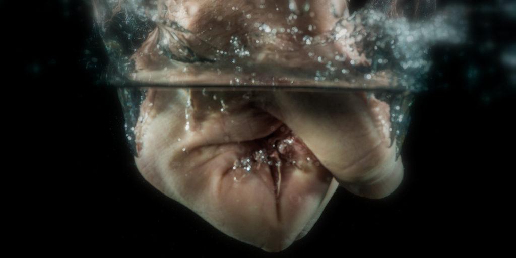 fist splashing into water