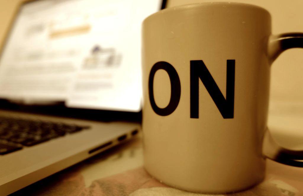 coffee mug saying on by computer