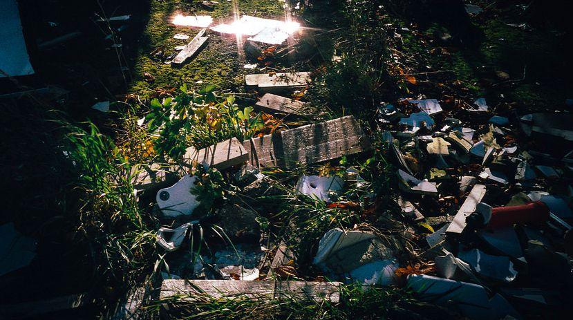 motivation garbage trash pile in grass