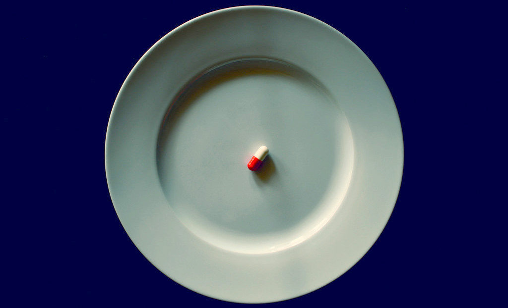 antiobiotic pill on a plate