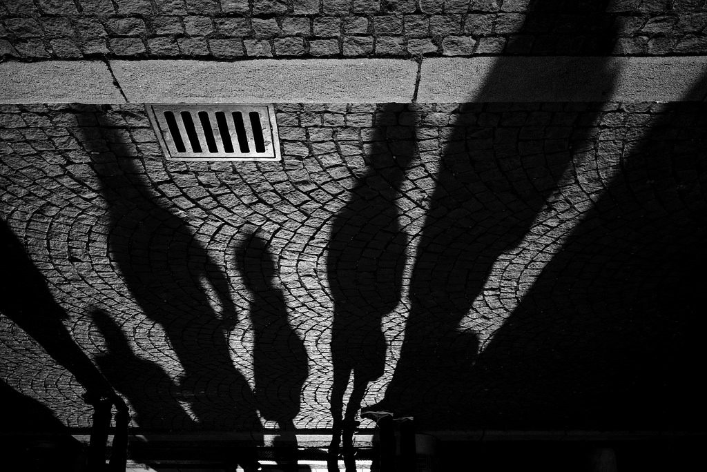 shadows standing on street