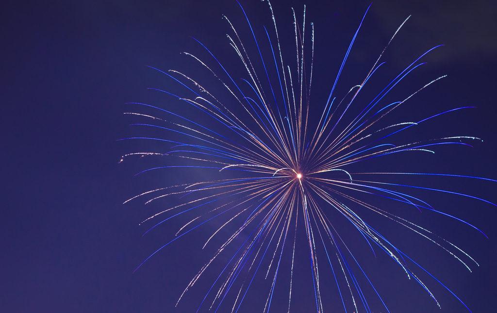 a big blue nighttime firework