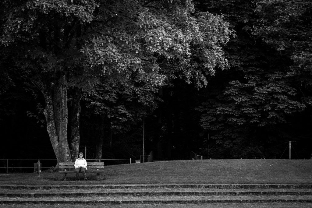 person lingering on a park bench