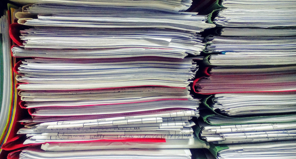 stacks of papers in folders