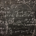 messy chalkboard with formulas