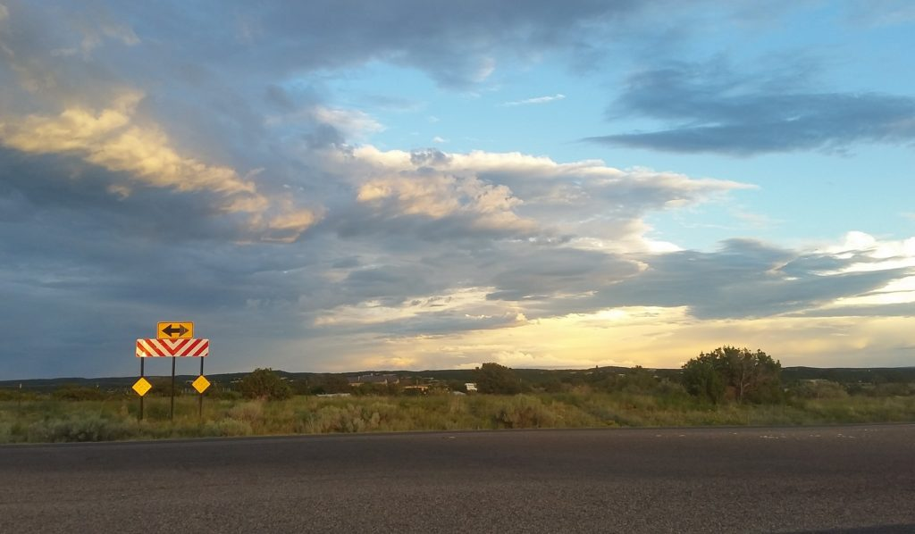 on the road in santa fe, sunset and road sign