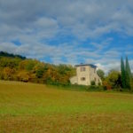 a tuscany stone up on a verdant hill