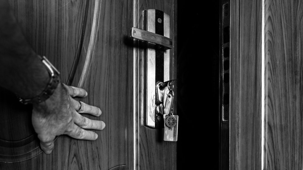 a hand pushing a door open for the easy way out