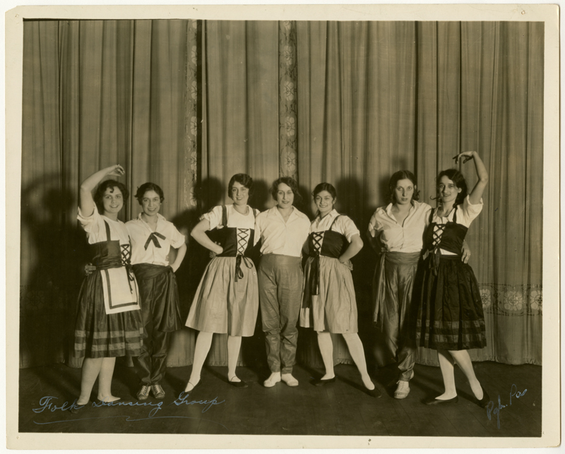 comedy women standing grouped on a stage