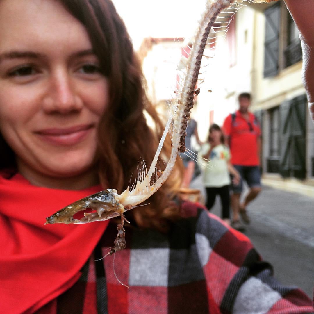 meggan holding a freshly eaten sardine